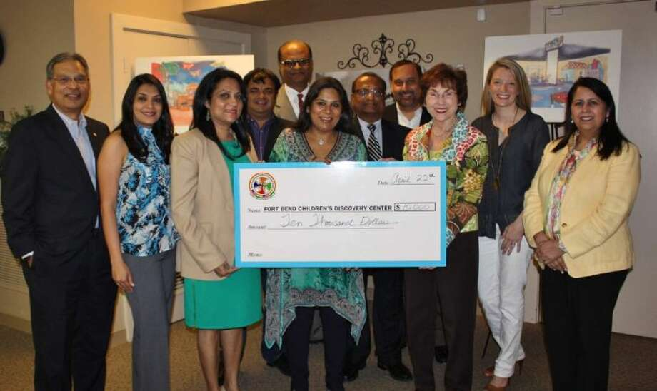 Front row: Harish Jajoo, Seema Sanghi, Jasmin Patel (IAF chairman), Shefali Jhaveri, Charlene Pate (FBCDC co-chair), Rachel Leaman (FBCDC co-chair) and Manmeet Likhari (FBCDC committee member). Back row: Vipul Anand, Naren Patel, KC Mehta and Hardeepak Munday. Photo: Children's Museum Of Houston