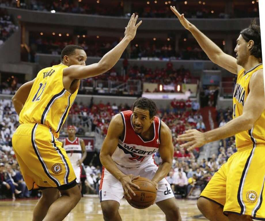 Washington Wizards guard Andre Miller, middle, is double teamed by the Pacers' Evan Turner, left, and Luis Scola. The Pacers won 93-80.