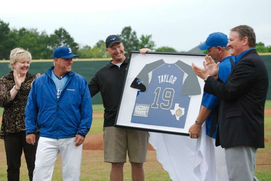 Friendswood head baseball coach Charlie Taylor (second from left) is honored during his final regular season game as a Mustang Tuesday night in Friendswood. Joing in the celebration are (from left) FISD Superintendent Trish Hanks, athletic director Robert Koopmann, assistant baseball coach Glen Newsom and FHS principal Mark Griffon. Photo: KIRK SIDES