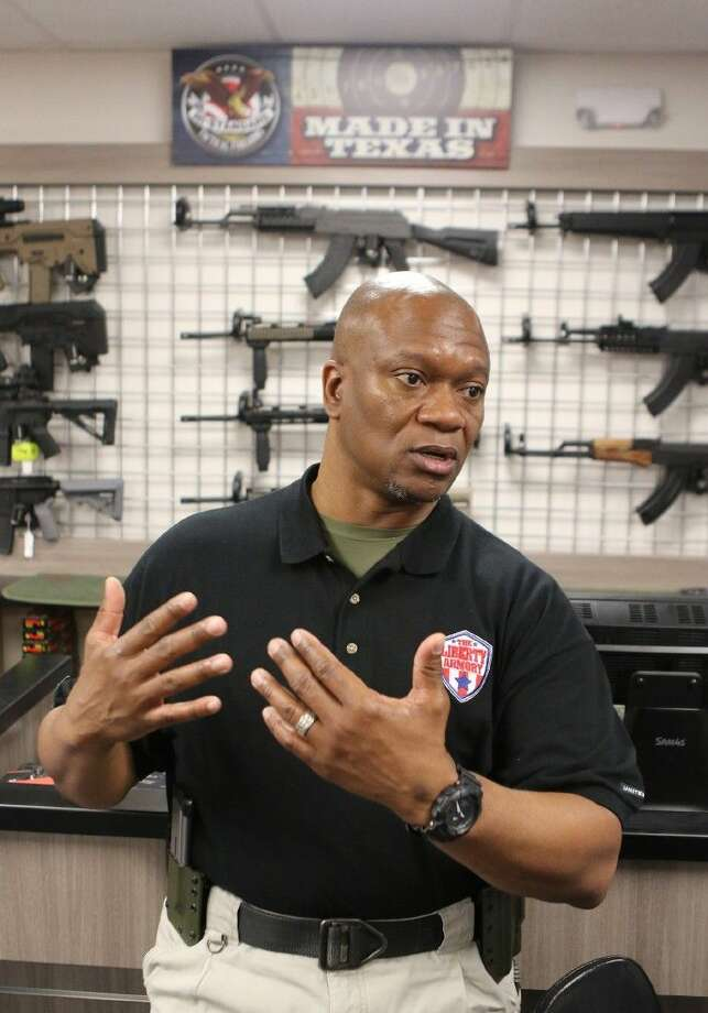 Lead Instructor Paul White talks about the Texas Senate approval of the open carry hand gun bill at The Liberty Armory in Bellaire, Texas on Thursday, March 19, 2015. Photo: Staff Photo By Alan Warren