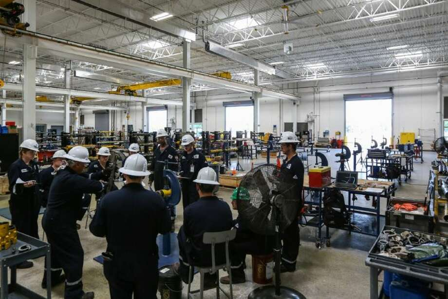 A class meets during the Baker Hughes Western Hemisphere Education Center grand opening on Thursday, May 15, 2014, in Tomball.