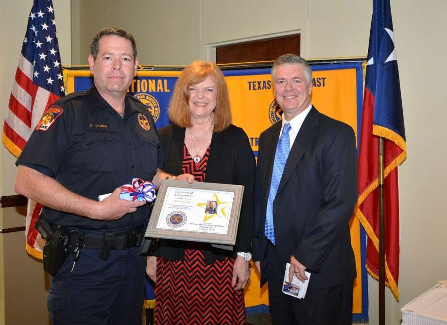 Memorial Villages Police Department Officer Frank Lermer was honored at the 50th annual Crime Prevention Luncheon by the Texas-Louisiana Gulf Coast District of the National Exchange Club. Fourteen local law enforcement officers were honored from twelve jurisdictions. Pictured with Officer Lermer is Susan Schwartz, luncheon chair and councilmember of Bunker Hill Village, and Asst. Chief Ray Schultz.