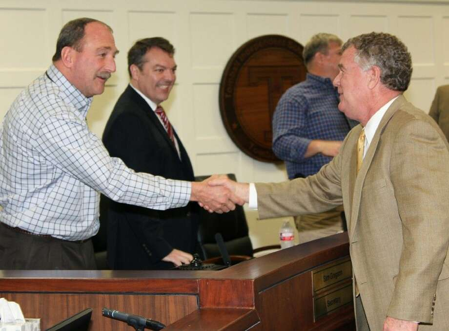 Tomball ISD Board Secretary Sam Gregson and Board Trustee Michael Pratt congratulated Ronny Peacock, director of athletics, for being selected as the Region 5 Texas High School Athletic Directors Association Athletic Administrator of the Year. Photo: Tomball ISD
