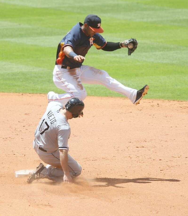 Astros shortstop Jonathan Villar leaps over Chicago's Adrian Nieto after recording the force at second base in the fifth inning. The Astros defeated the White Sox 8-2.