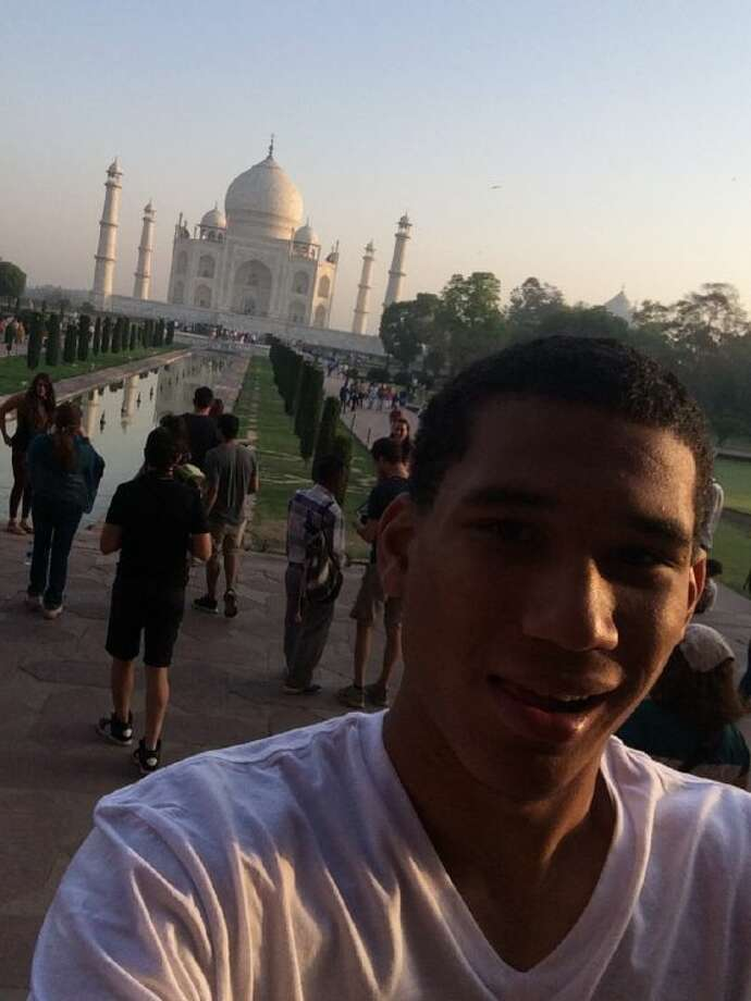 Johnathan Lohner stops in front of the Taj Mahal in Agra, India.