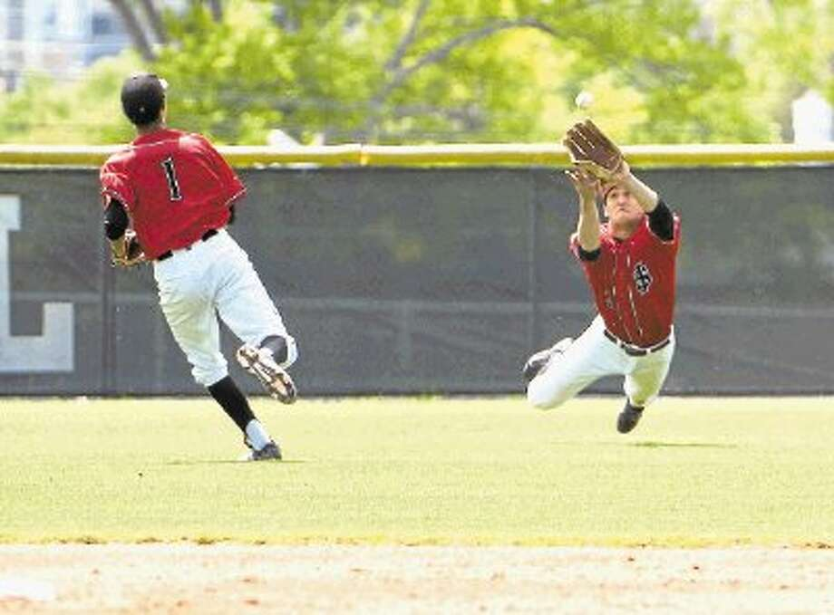 St. John's center fielder Daniel Halevy makes a sensational catch for the Mavericks during a Southwest Preparatory Conference South Zone game. Halevy was one of the many boy and girl athletes named to the SPC All-Spring team and Halevy was a first-teamer in baseball. Photo: Kevin B Long / ©2014 Gulf Coast Shots, All rights reserved.