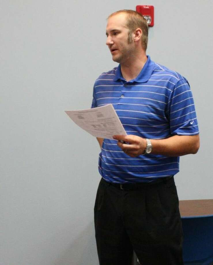 Shepherd ISD Business Manager J.W. Kirkham presents the plans for the cooperative with Coldspring-Oakhurst CISD's JROTC program. Photo: JACOB MCADAMS