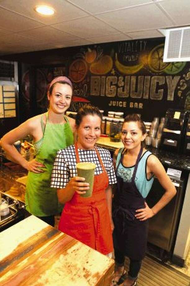 From left to right, Michele Baum, Sarah Schnitzer and April Flores with a smoothie at the Big & Juicy juice bar in Houston. Photo: Alan Warren / HCN
