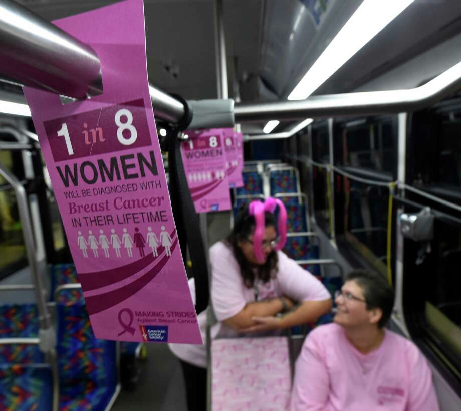 "Sherri Plunkett, treasury supervisor for CDTA, left, joins her sister and breast cancer survivor Dawn Ruchel at the CDTA bus garage for the kickoff of the CDTA Turns Pink to ""Make Strides Against Breast Cancer"" program on Monday Oct. 3, 2016, in Albany, N.Y.   (Skip Dickstein/Times Union) Photo: SKIP DICKSTEIN / 40038230A"