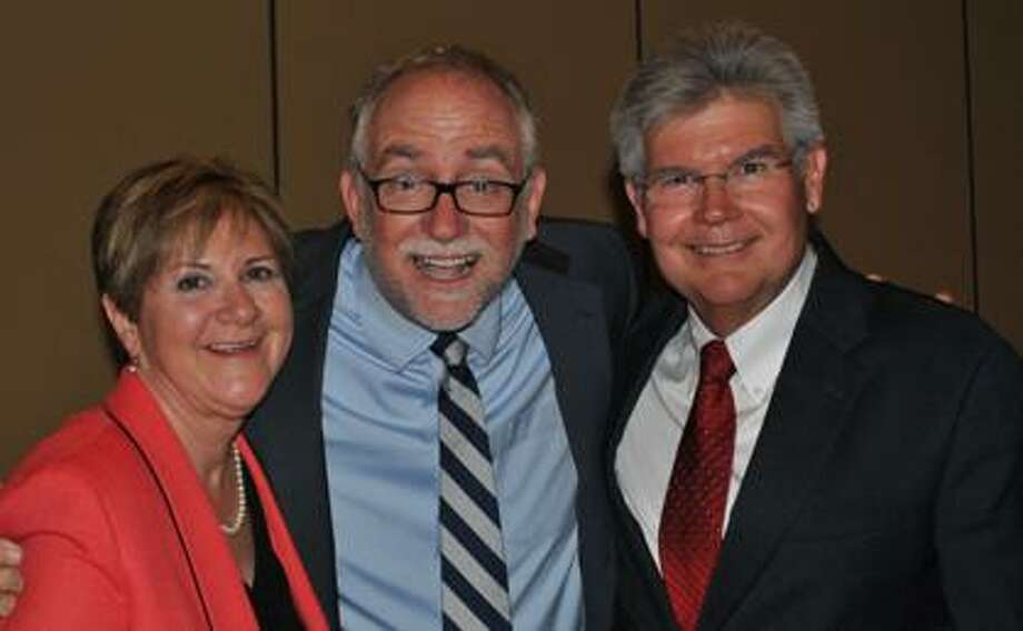"""More than 200 people gathered for a high-energy night with Bob Goff, New York Times best-selling author of """"Love Does,"""" at the 2014 NAM Endowment Dinner. Pictured from left to right are Carole Little, President & CEO of NAM; author and speaker Bob Goff; and Buddy Bolt, Chair of the NAM Endowment Board."""