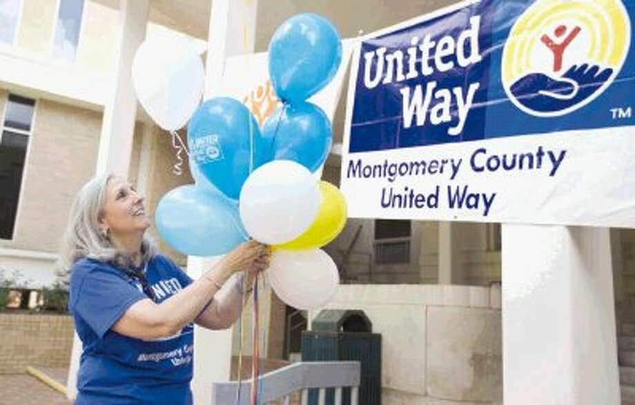 Montgomery County United Way President Julie Martineau hangs balloons at the Fifth Annual Montgomery County United Way's Volunteer Appreciation Celebration luncheon at the Montgomery County Courthouse Thursday. Photo: Jason Fochtman / Conroe Courier / HCN