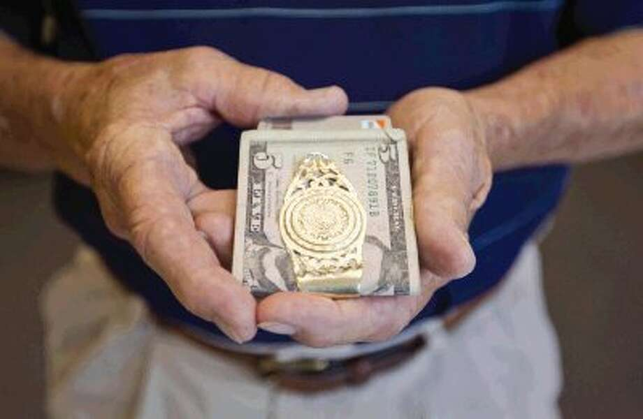 Don Bradshaw's money clip containing money, credit cards, driver's license and other items was returned to him intact after he lost it while attending the Ironman triathlon last Saturday. / Conroe Courier / HCN