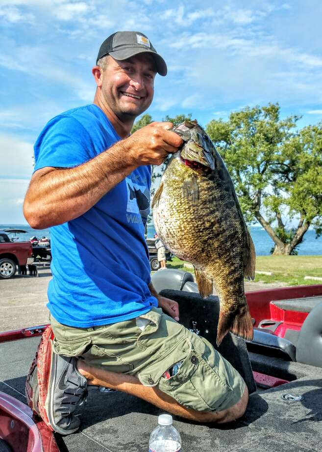 Click through the slideshow to see some big (and little) local catches. Germantown, N.Y. resident Patrick Hildenbrand caught an 8 lb. 4 oz. smallmouth bass from the St. Lawrence River on August 28 during a fishing tournament in the Thousand Islands Region, New York. Photo: DEC