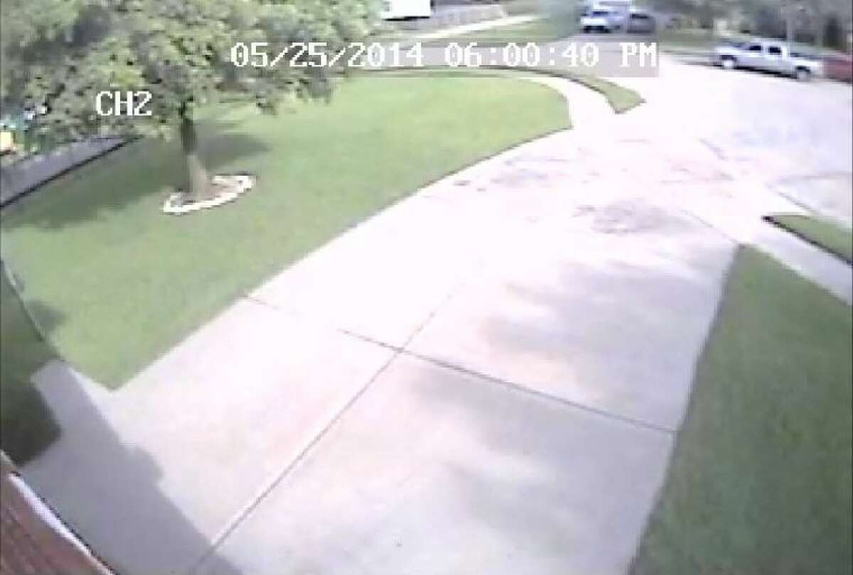 Surveillance footage during the home invasion/robbery of an elderly Houston women. The vehicle in the upper-right-hand corner appears to be a late-model Chevrolet four-door silver or gray pickup truck, believed to be driven by the suspects.