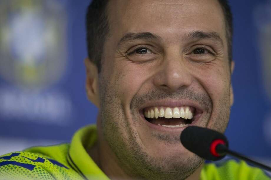 Brazil goalkeeper Julio Cesar answers questions during a news conference at the Granja Comary training center on Tuesday in Teresopolis, Brazil.