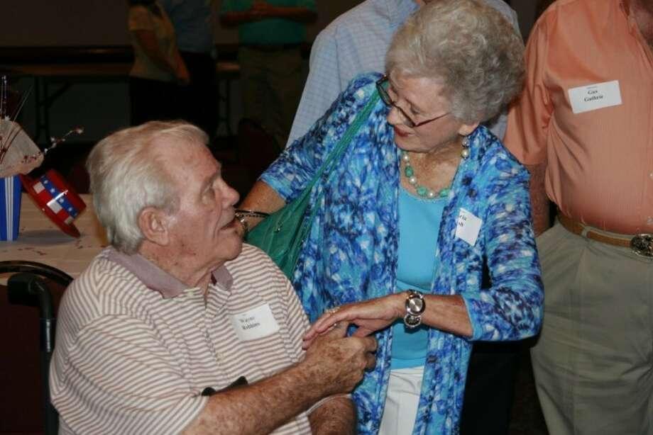 Old classmates reunite during a past Humble High School Alumni Celebration.