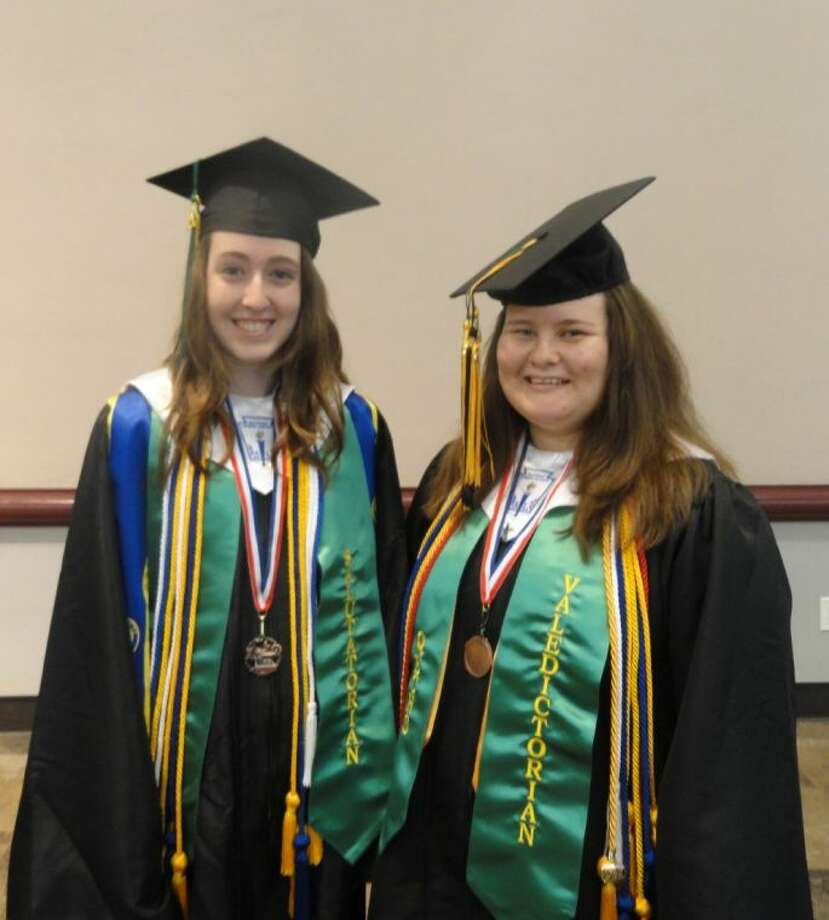 The valedictorian of the 2014 QECHS graduating class is Grace Justice Castillo Caldwell, right, and the salutatorian is Sarah Bayless.
