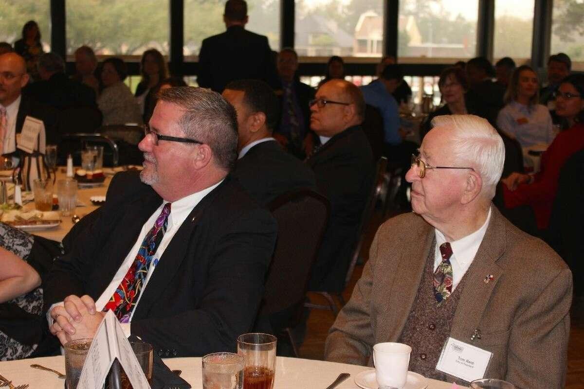 Sebesta and Mayor Tom Reid listen to the Chamber of Commerce meeting.