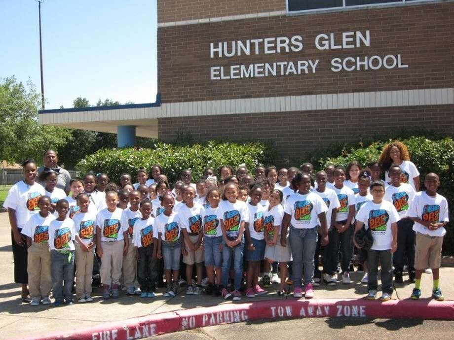 Shown with the Hunters Glen marathon runners are Principal Angela Dow and PE teacher Lewis Rhone (left) and Music teacher Theresa Grayson (right). Photo: Photo Courtesy FBISD