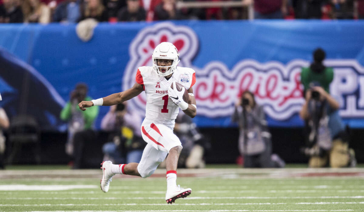 University of Houston junior quarterback Greg Ward Jr. darts for a first down against the Florida State Seminoles during the 2015 Peach Bowl at the Georgia Dome on Thursday afternoon, December 31, 2015. Ward Jr. accounted for three touchdowns in the game, two rushing and one passing. (Ben Solomon/American Athletic Conference)