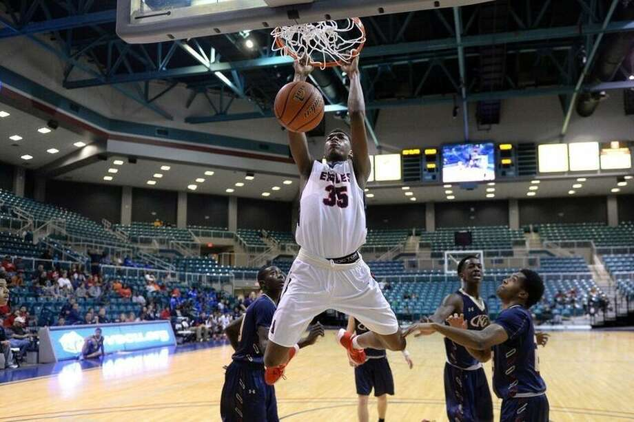 Atascocita's Fabian White (35) throws a dunk in against Klein Collins earlier this season for the Eagles.