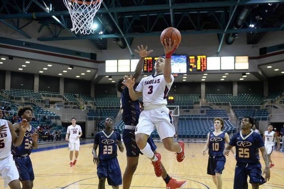 Atascocita's Carsen Edwards attempts a layup earlier this season in a game for the No. 1 Eagles.