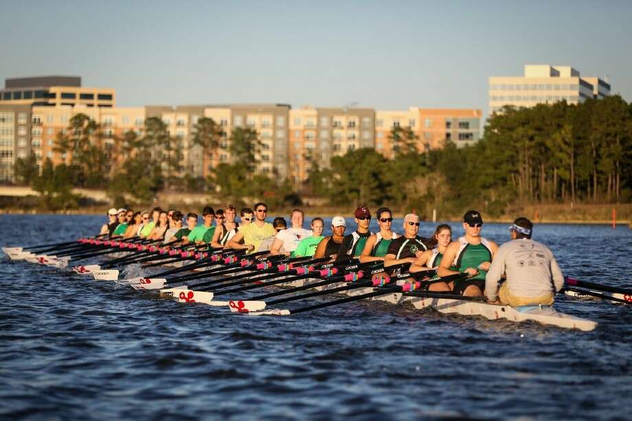 24 members of The Woodlands Rowing Club test out the Sweden-based, 144-foot Stampfli racing boat on Monday on Lake Woodlands. Photo: Michael Minasi