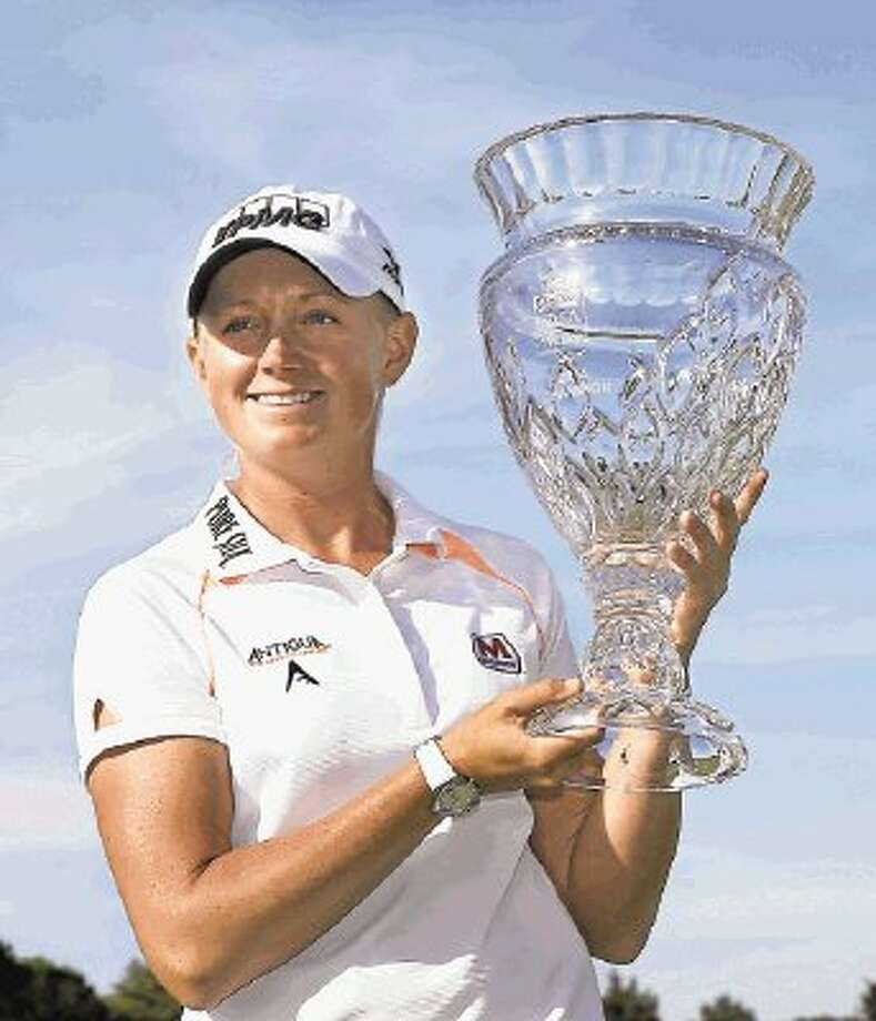 Stacy Lewis holds up the trophy after winning the ShopRite LPGA Classic golf tournament in Galloway Township, N.J., Sunday, June 1, 2014. Lewis shot 16-under-par, 197 to win the tournament. (AP Photo/Mel Evans) / AP2014