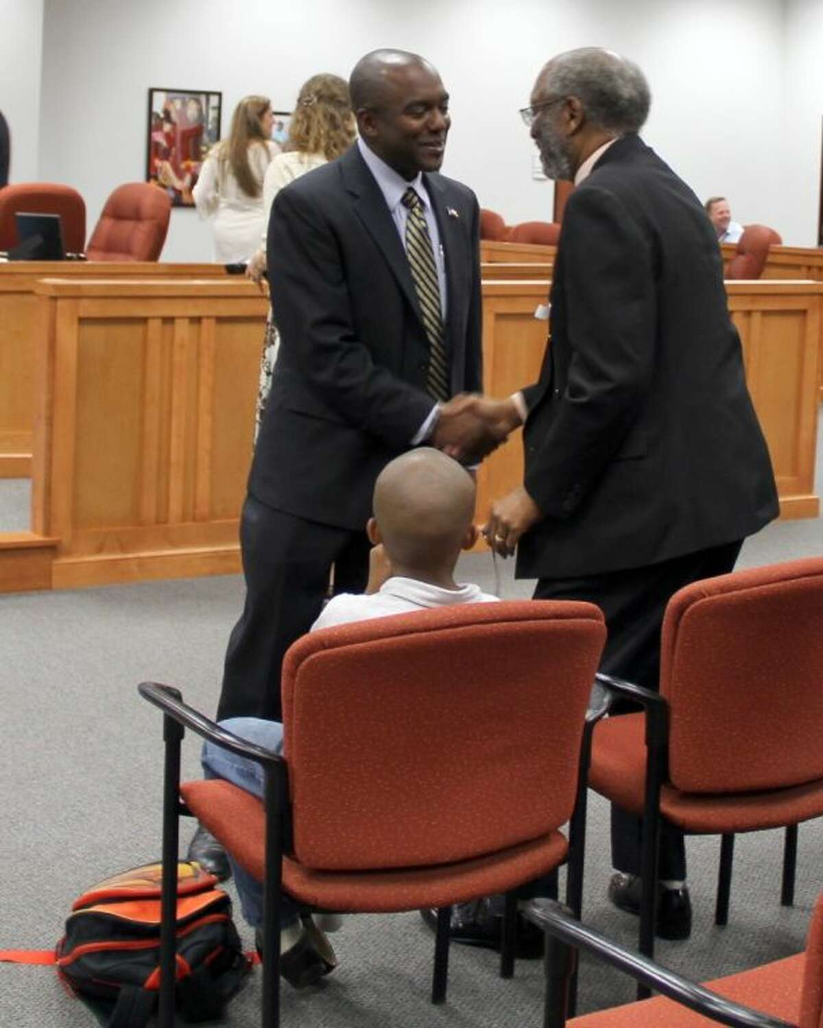 Pearland ISD trustee Charles Gooden Jr., left, shown with his father, Charles Gooden Sr., disavowed a letter urging support for his re-election.
