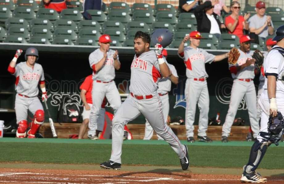 Houston's Frankie Ratcliff scores against Rice on Feb. 19 at Reckling Park in Houston. The Cougars defeated LSU twice to win the Baton Rouge Regional. Photo: Alan Warren