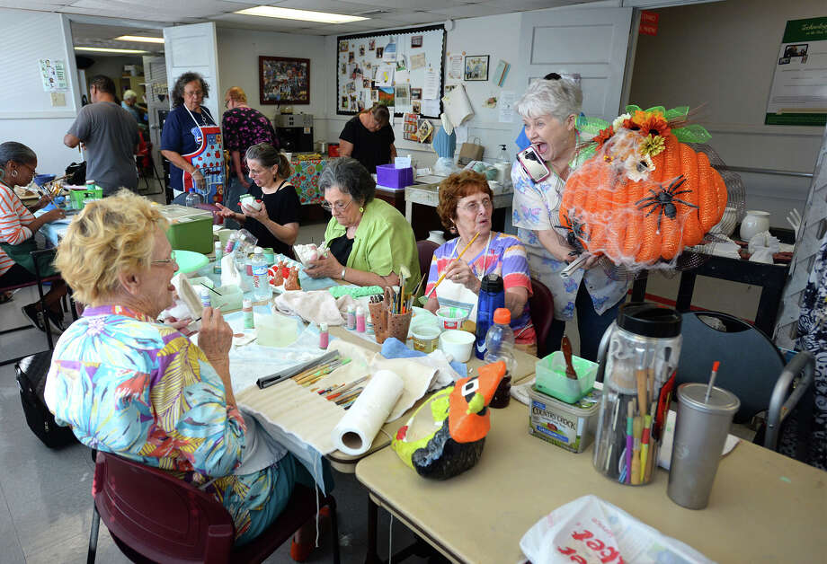 Maggie LaBove shows Halloween decorations to the ceramics class at the Best Years Center Monday morning. Construction on the Center's new downtown facility has begun with expectations of completion in early 2018. Photo taken Monday, October 03, 2016 Guiseppe Barranco/The Enterprise Photo: Guiseppe Barranco, Photo Editor