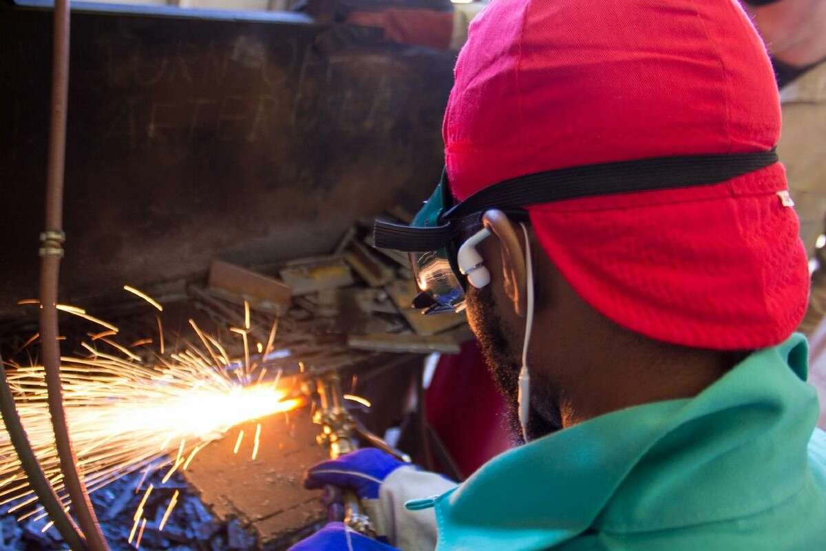 A student welds in the lab at College of the Mainland.Whether welding or making a Subway sandwich, workers have been denied dignity and purpose, says Elizabeth Bruenig. It didn't used to be that way. It doesn't have to be that way.