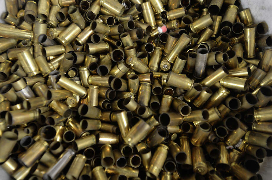 Spent Shell casings fill buckets at the Lone Star Indoor Gun Range, which was the locale for the first meeting of the newly-formed Pretty Pistols and Pearls Women's Shooting Club Thursday. The club will have scheduled meetings one Thursday a month, and members will be able to shoot at the range on Thursdays for a discounted fee. 
