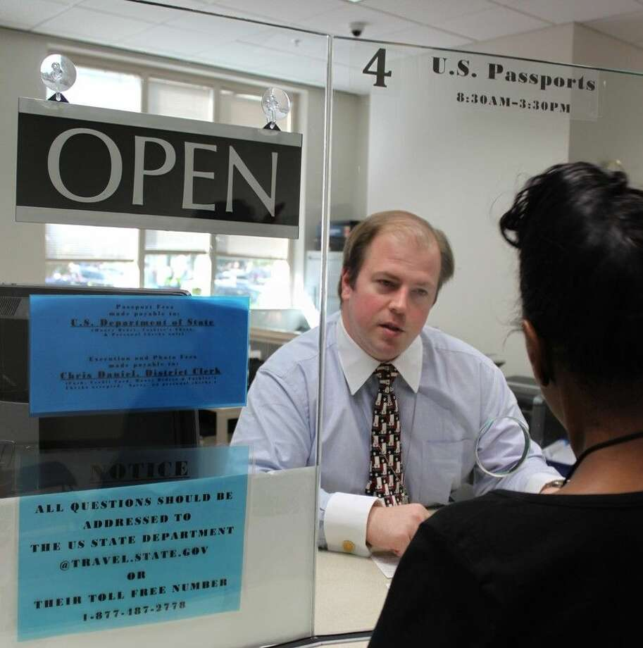 Harris County District Clerk Chris Daniel helps out by manning a window in the District Clerk's downtown passport office.