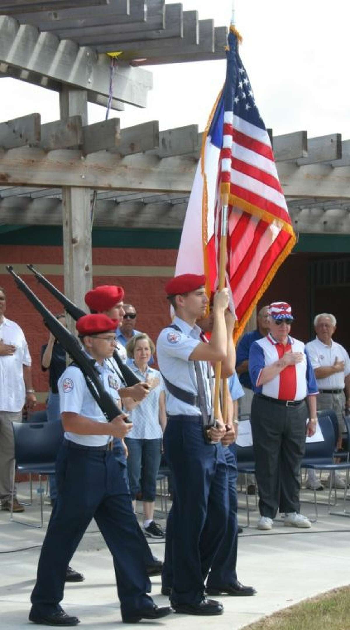 Cleveland AFJROTC cadets present the colors during the opening ceremony for the Cleveland Municipal Park.