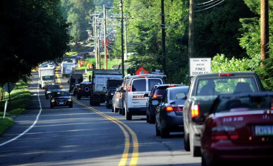 Morning traffic on Route 35, near the intersection with Farmingville Road heading into downtown Ridgefield is congested, Tuesday, July 26, 2016. A new DOT Plan will replace traffic lights at the intersection of Rt. 35, Copps Hill Road and Farmingville Road. Photo: Carol Kaliff / Carol Kaliff / The News-Times