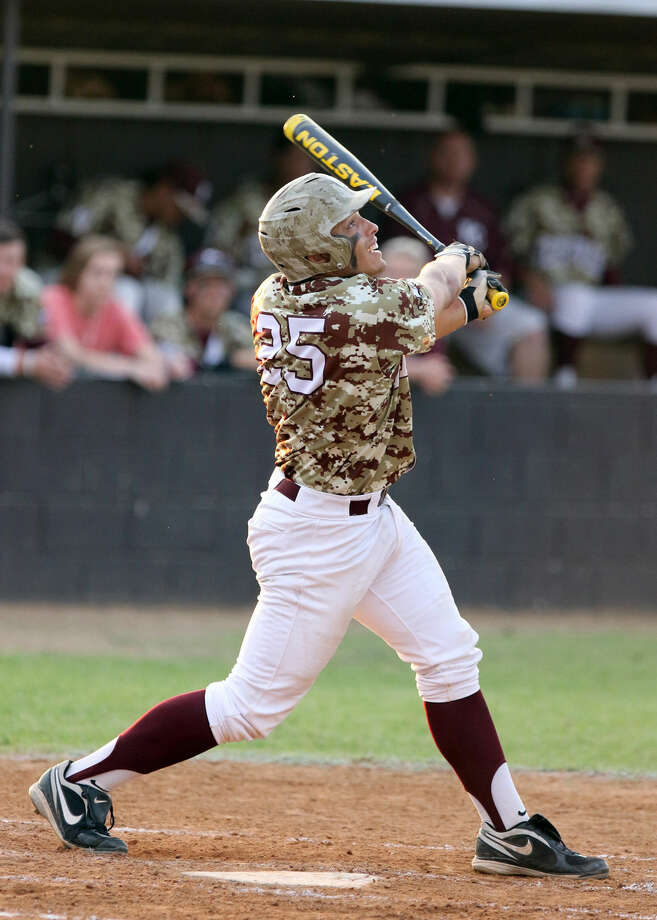Kempner's Justice Brown hits against Austin during their May 1 district game at Kempner High School in Sugar Land. To view or purchase this photo and others like it, go to HCNPics.com. Photo: HCN File Photo