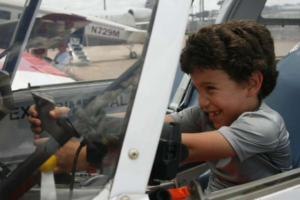 Sam Rudin, a second grade student at River Oaks Elementary, had the chance to check out one of the small planes during George Bush Intercontinental Airport Houston's 45th Anniversary Celebration June 7, 2014.