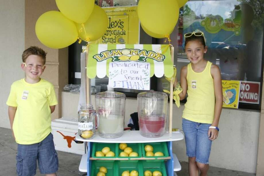 Hunter and Haven Noe set up their first of many lemonade stands benefiting Alex's Lemonade Stand Foundation outside of Kingwood's Toys and Candy On the Park June 7, 2014.