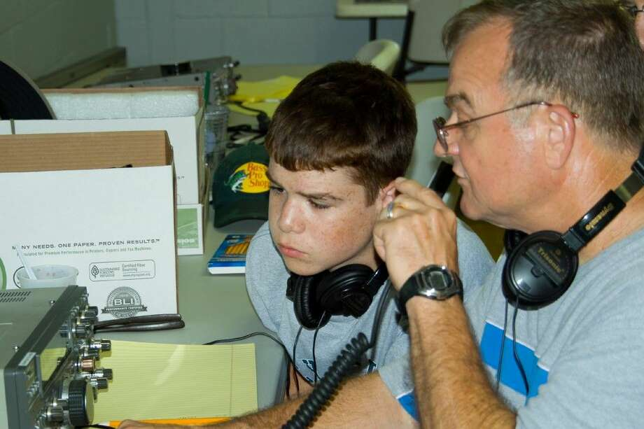 Phil Burrow, KJ5OW instructing Stephen Manning on ham radio use. Students in the class will learn the basics of ham radio operation as well as different modes of communication.