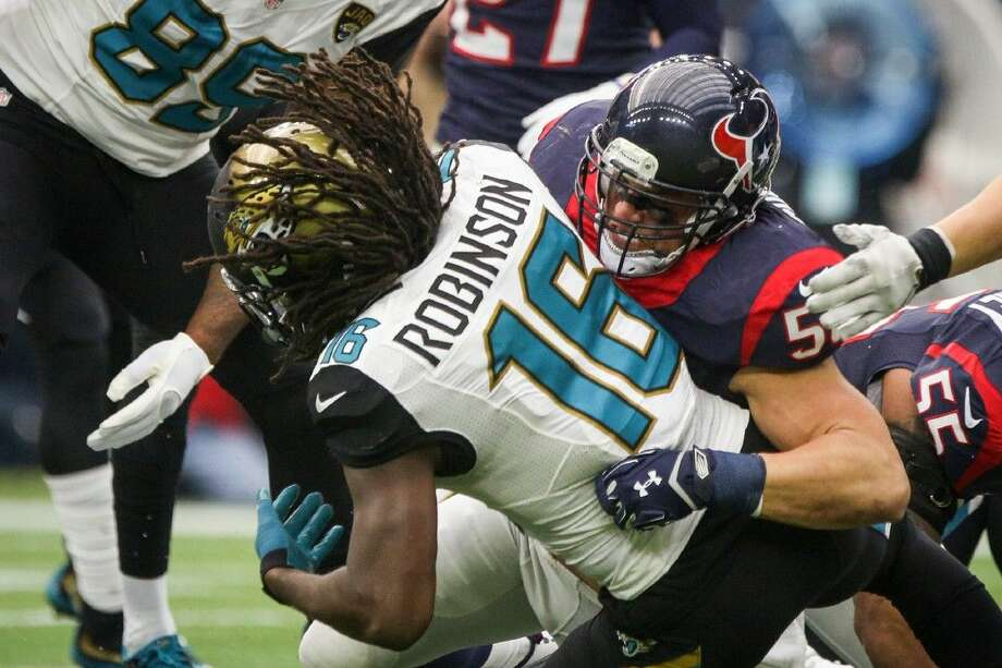 Inside linebacker Brian Cushing, of the Houston Texans, tackles running back Denard Robinson, of the Jacksonville Jaguars, during the NFL football game on Sunday, Jan. 3, 2016, at NRG Stadium. To view more photos from the game, go to HCNPics.com.