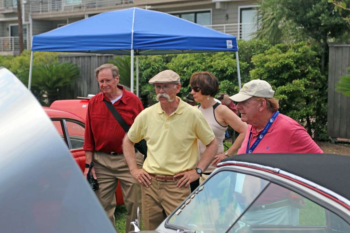 The Grand Marshal this year at Keels and Wheels was Dennis Gage, wearing yellow, who is the host of My Classic Car television show.