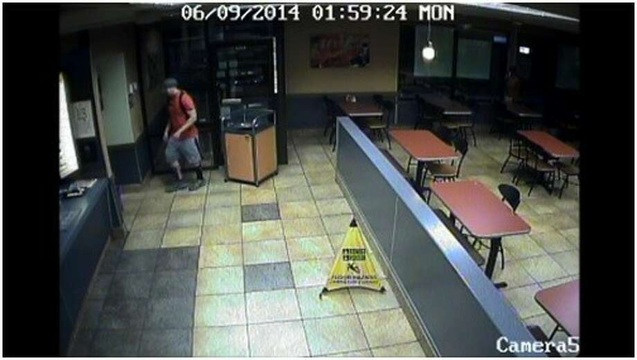 Security cameras captured the image of a man suspected of a June 9 armed robbery of Jack in the Box in Liberty.