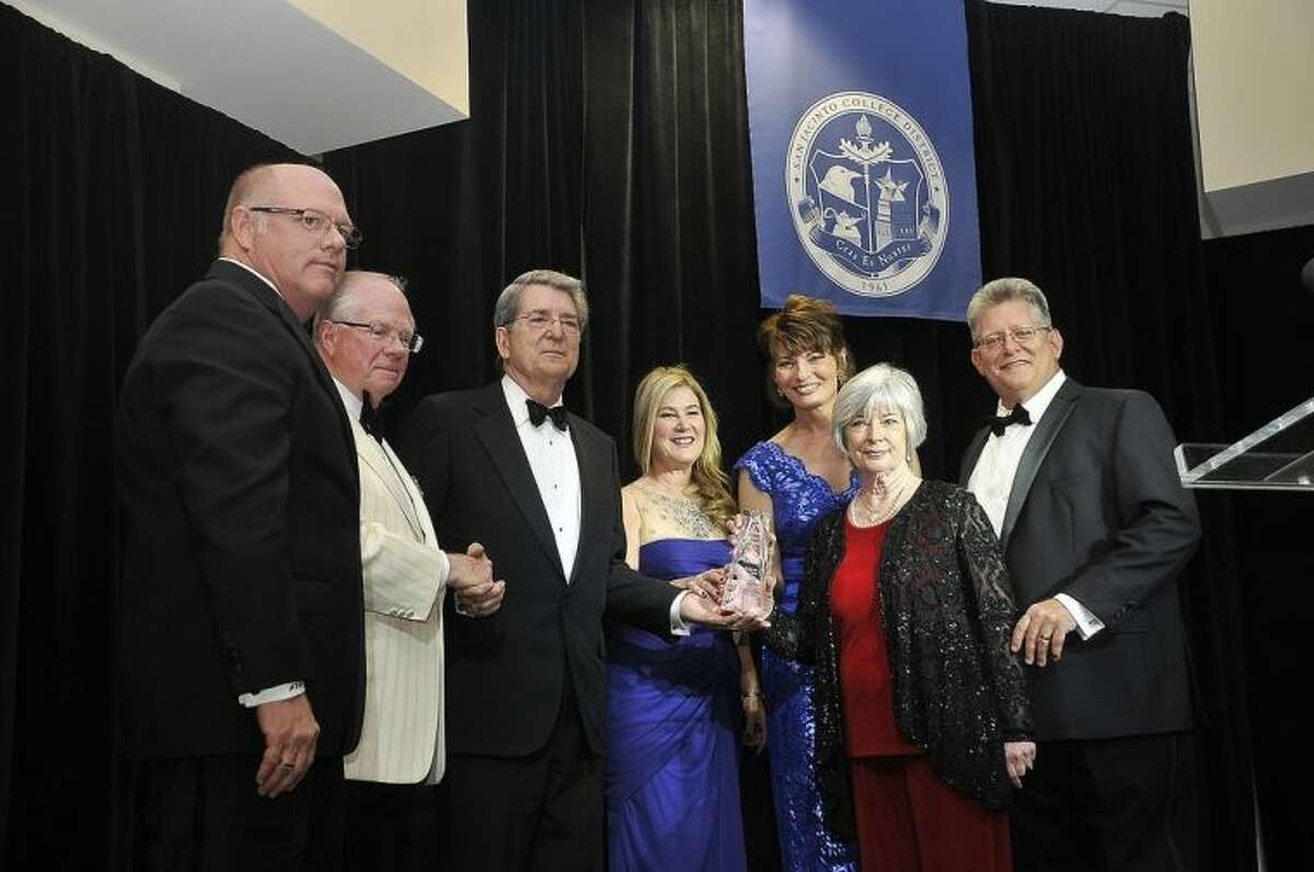 Members of the San Jacinto College community honored John and Rose Moon with the first-ever Legacy Award at the 2014 San Jacinto College Foundation gala. Pictured, left to right, are: Mr. Dan Mims, Chair, San Jacinto College Board of Trustees; Mr. Frank Nadolney, Chair, San Jacinto College Foundation Board of Directors; Mr. John Moon, Sr.; Ruth Keenan, Executive Director, San Jacinto College Foundation; Dr. Brenda Hellyer, Chancellor, San Jacinto College; Mrs. Rose Moon; Mr. John Moon, Jr., Secretary, San Jacinto College Board of Trustees. Photo credit: Andrea Vasquez, San Jacinto College marketing, public relations, and government affairs.