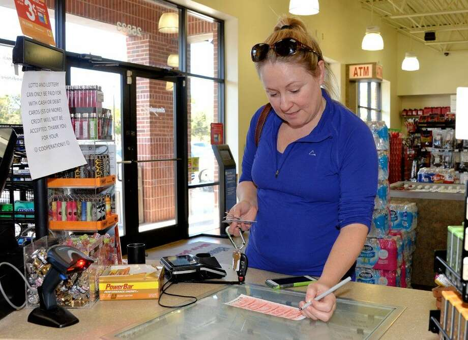 Bonnie Austin made her Powerball picks late this afternoon with hopes of winning the jackpot. Photo: Craig Moseley