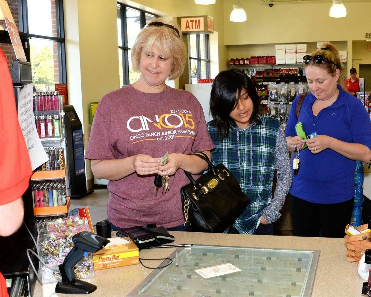 From left, Susan Jackson, Sydney Jackson, and Bonnie Austin beat the long lines for their tickets. Texas was averaging more than $1M in lotto ticket sales per hour throughout the day today. Yesterday Texas saw its best hour of Powerball sales at $3,011,972 from 6 p.m. to 7 p.m.