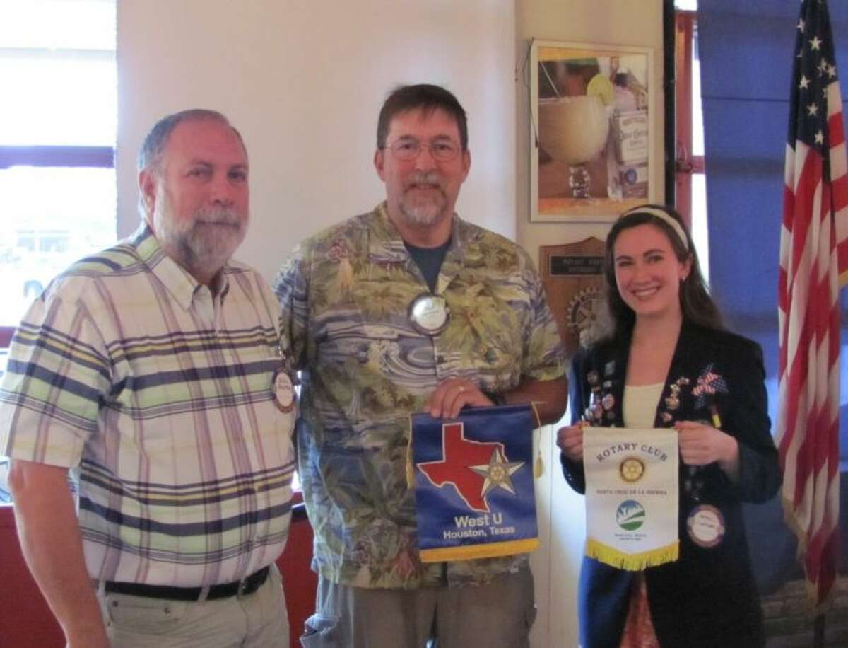Joanna LeFebvre, right, with West U Rotary Club President Wally Kronzer, center and one of her two Rotary Youth Exchange dads, Xavier