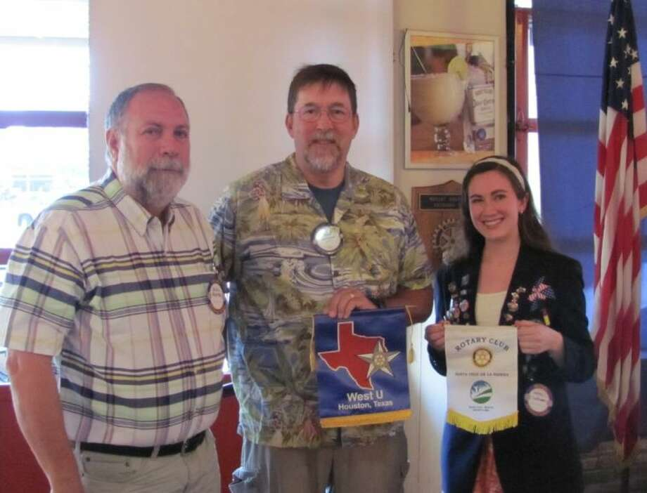 """Joanna LeFebvre, right, with West U Rotary Club President Wally Kronzer, center and one of her two Rotary Youth Exchange dads, Xavier """"Chi Chi"""" Mendez of Santa Cruz de la Sierra, Bolivia."""