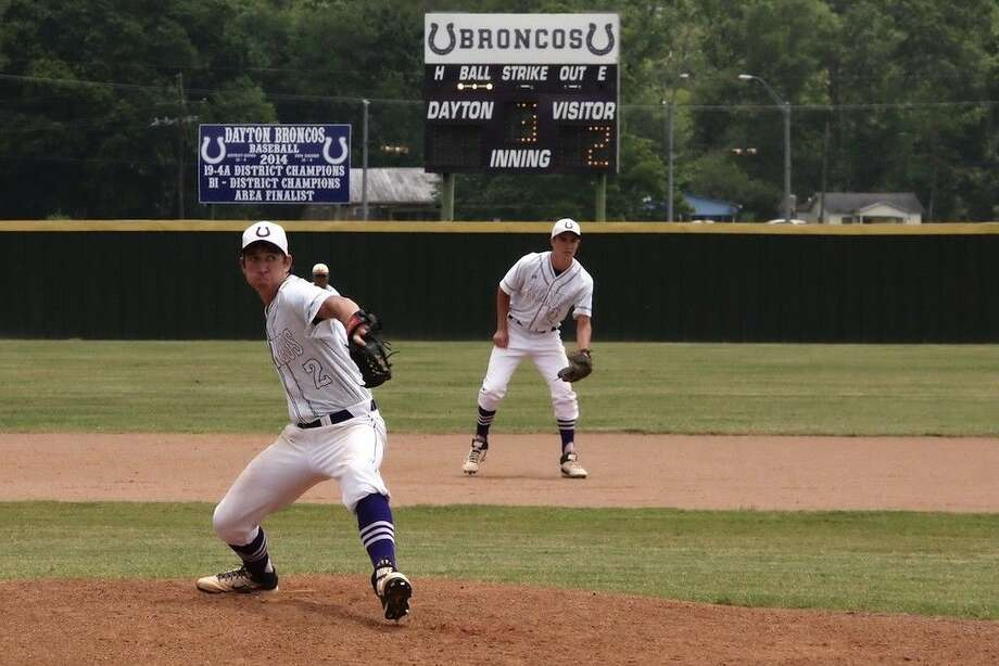 Josh Eckerman pitched game two of Dayton's b-district series against Goose Creek Memorial, May 9, 2015. He is shown here with Austin Hanel playing second in what turned into a tough third inning for the Broncos. GCM jumped ahead, 6-0, in the third. Dayton caught up in the fifth, but then fell by one point to GCM, 8-7. Photo: Casey Stinnett