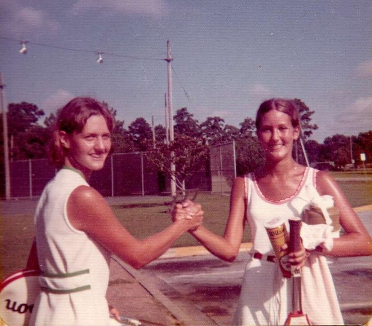 Jan Heuer, on the right, and her high school doubles partner Linda Roco Taylor at the 1973 Shakey's Junior Open Tennis Tournament for the Houston City Championship, held at the former Southwest Tennis Center, now named for Lee LeClear, and Memorial Park. Heuer took lessons from LeClear while he was manager and tennis pro at the center.